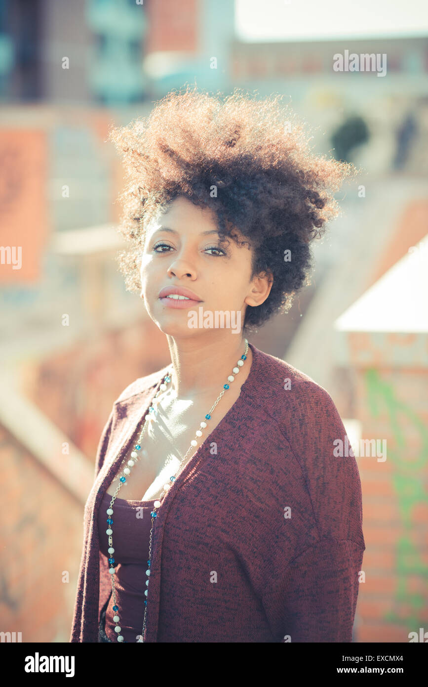 beautiful black curly hair african woman in town - Stock Image