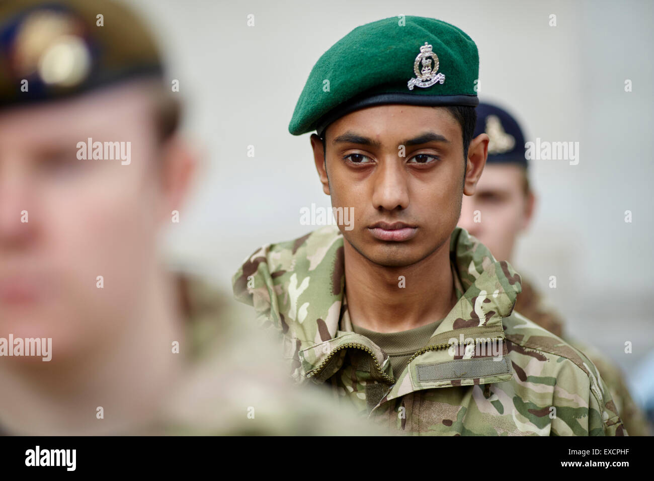 ARMED FORCES DAY IN MANCHESTER CITY CENTRE.  Green berry cap cadet asian black Man men male his him he gentleman - Stock Image