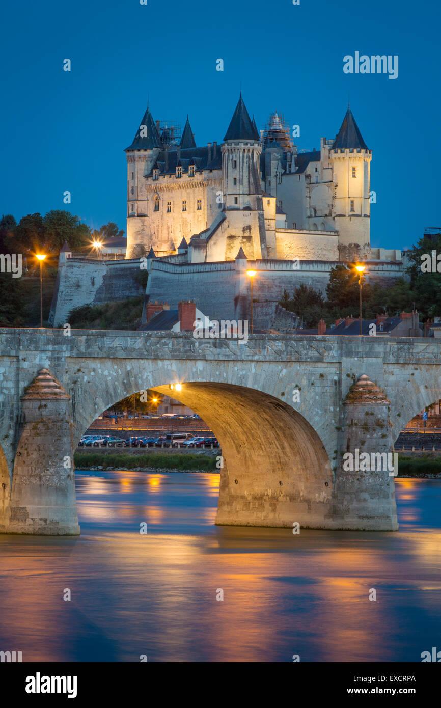 Twilight over Chateau Saumur (b. 12th century), Pont Cessart and River Loire, Maine-et-Loire, Centre, France - Stock Image