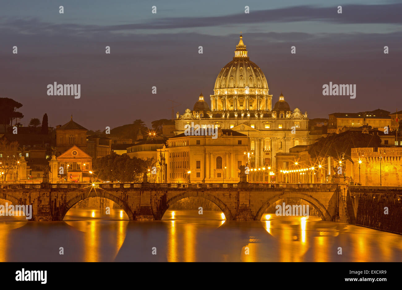 Rome - Angels bridge and St. Peters basilica in evening dusk - Stock Image