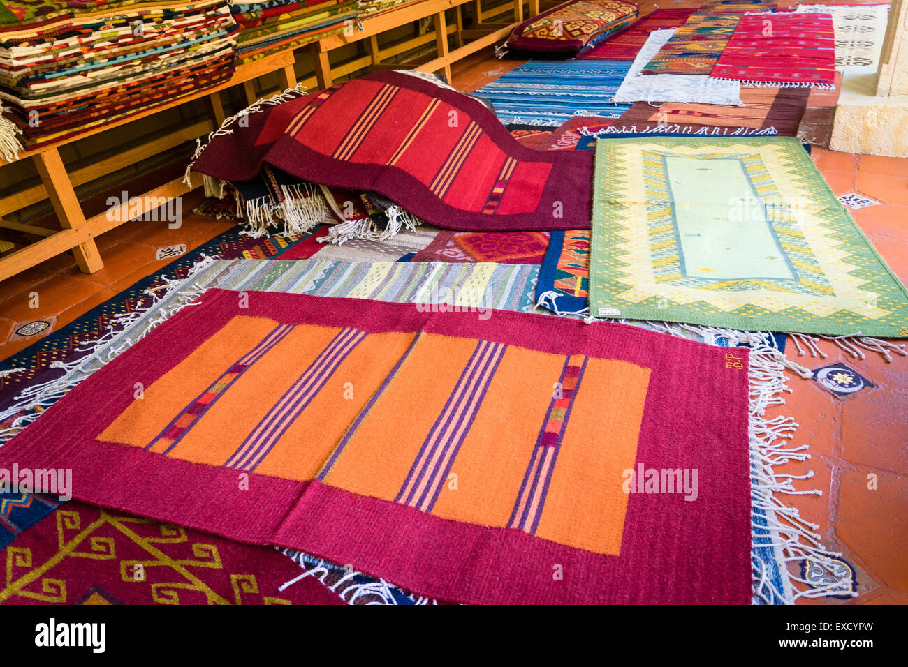 Traditional handmade woven rugs on display at a weaver's shop in Teotitlan del Valle in Oaxaca Mexico Stock Photo