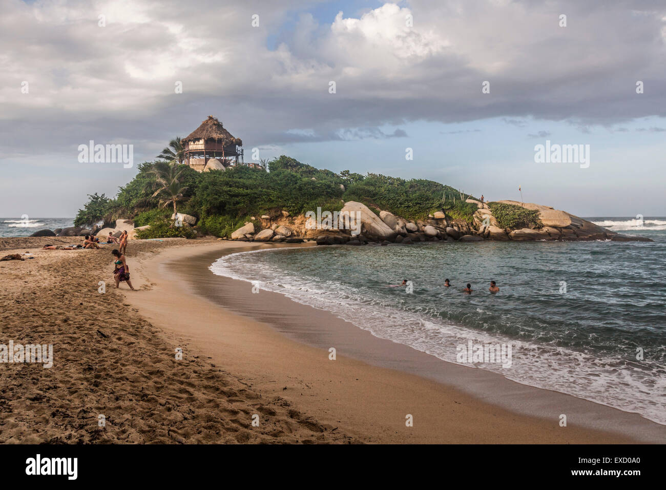View of the beach and palapa where one can rent a hammock for the night at Cabo San Juan in Tayrona National Park - Stock Image