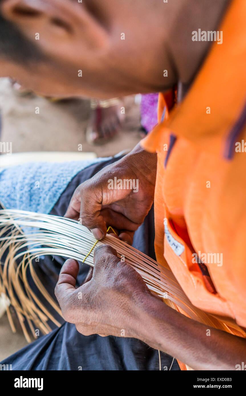 d6acaab2d75 Wayuu indigenous man constructing a bamboo hat in the regional style of La  Guajira