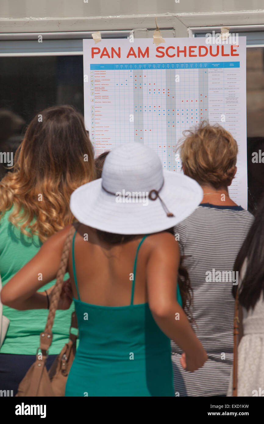 People looking at 2015 PanAm  games schedule,Toronto, Canada - Stock Image