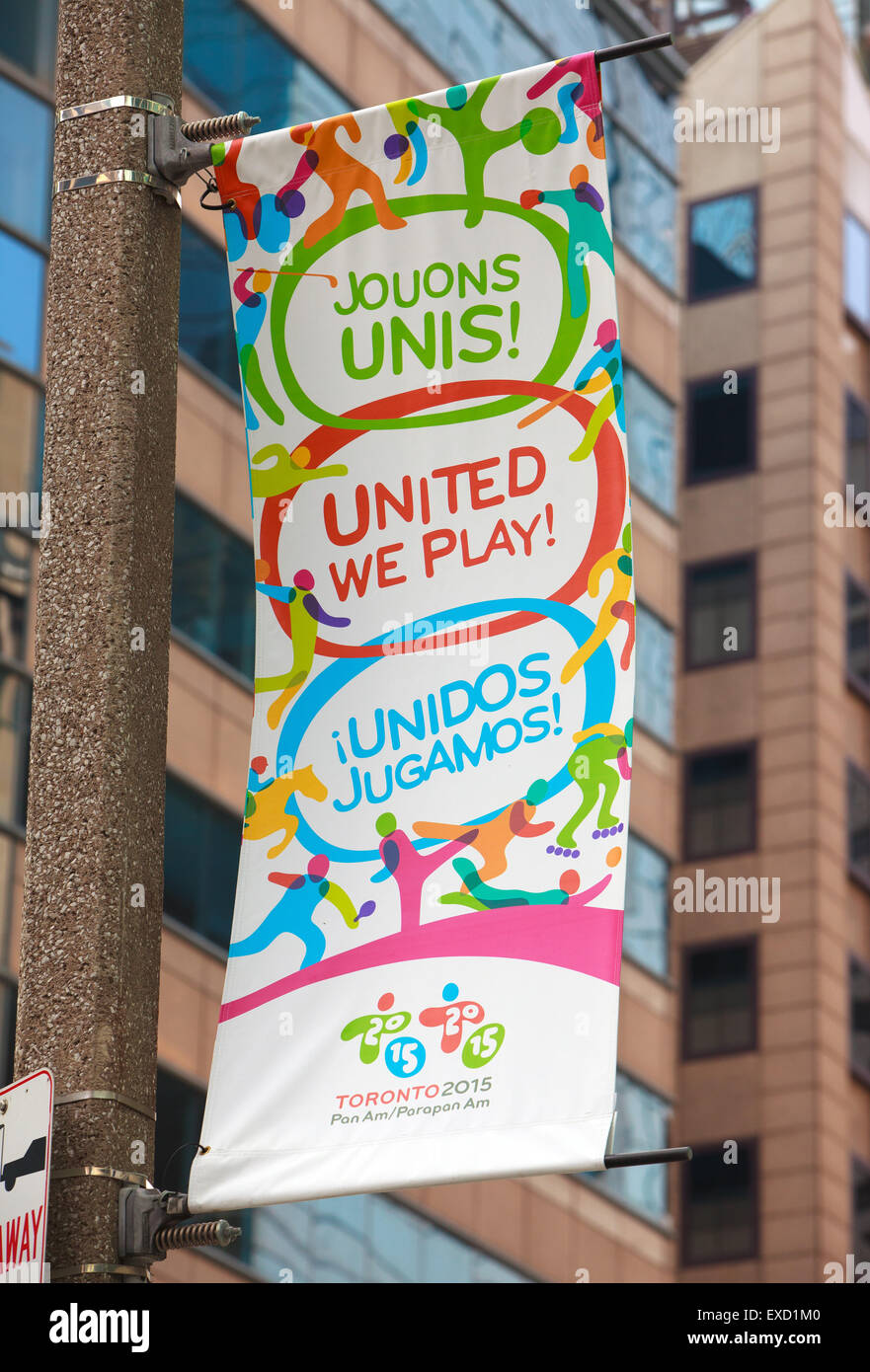 2015 PanAm games banner with 'United we play' motto  in three different languages (TORONTO,CANADA) - Stock Image