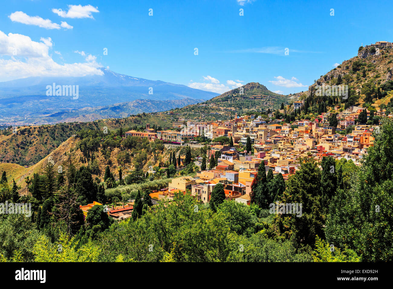 Village of Taormina and Mount Etna, Messina District, Sicily, Italy - Stock Image