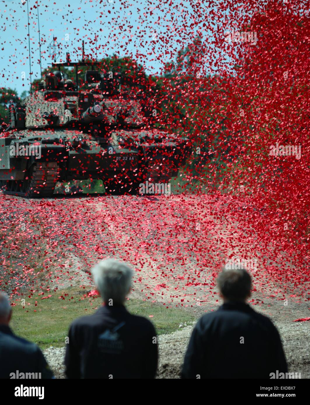 A tank is shrouded in poppies during the World War I centenary event at Bovington Tank Museum 2014. - Stock Image