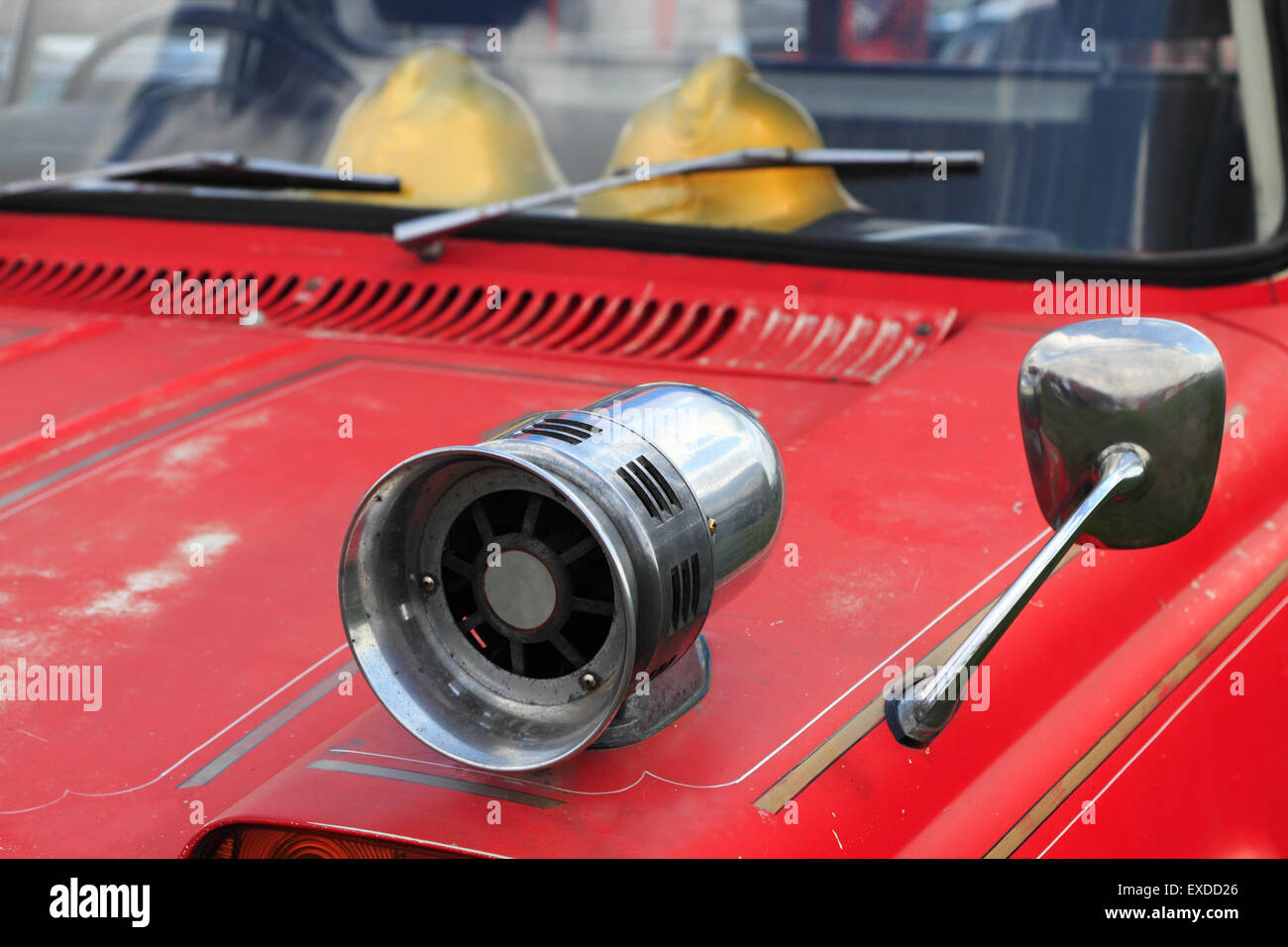 Closeup of old fire truck with a siren on the fender. Stock Photo