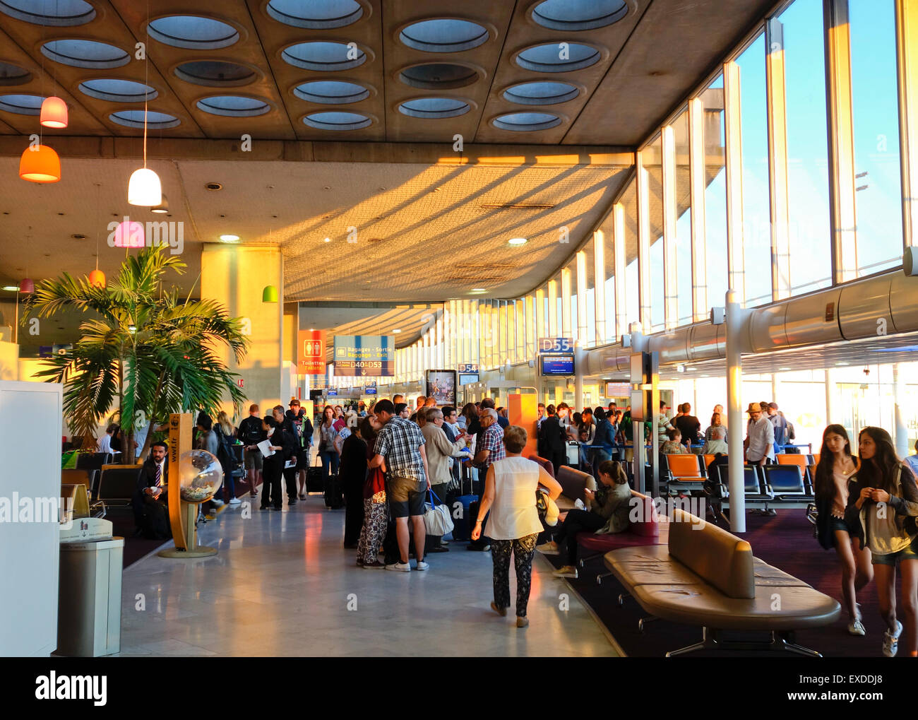 Terminal 2d Gates, passengers waiting to board plane at Charles de Gaulle, airport, Paris, France. - Stock Image