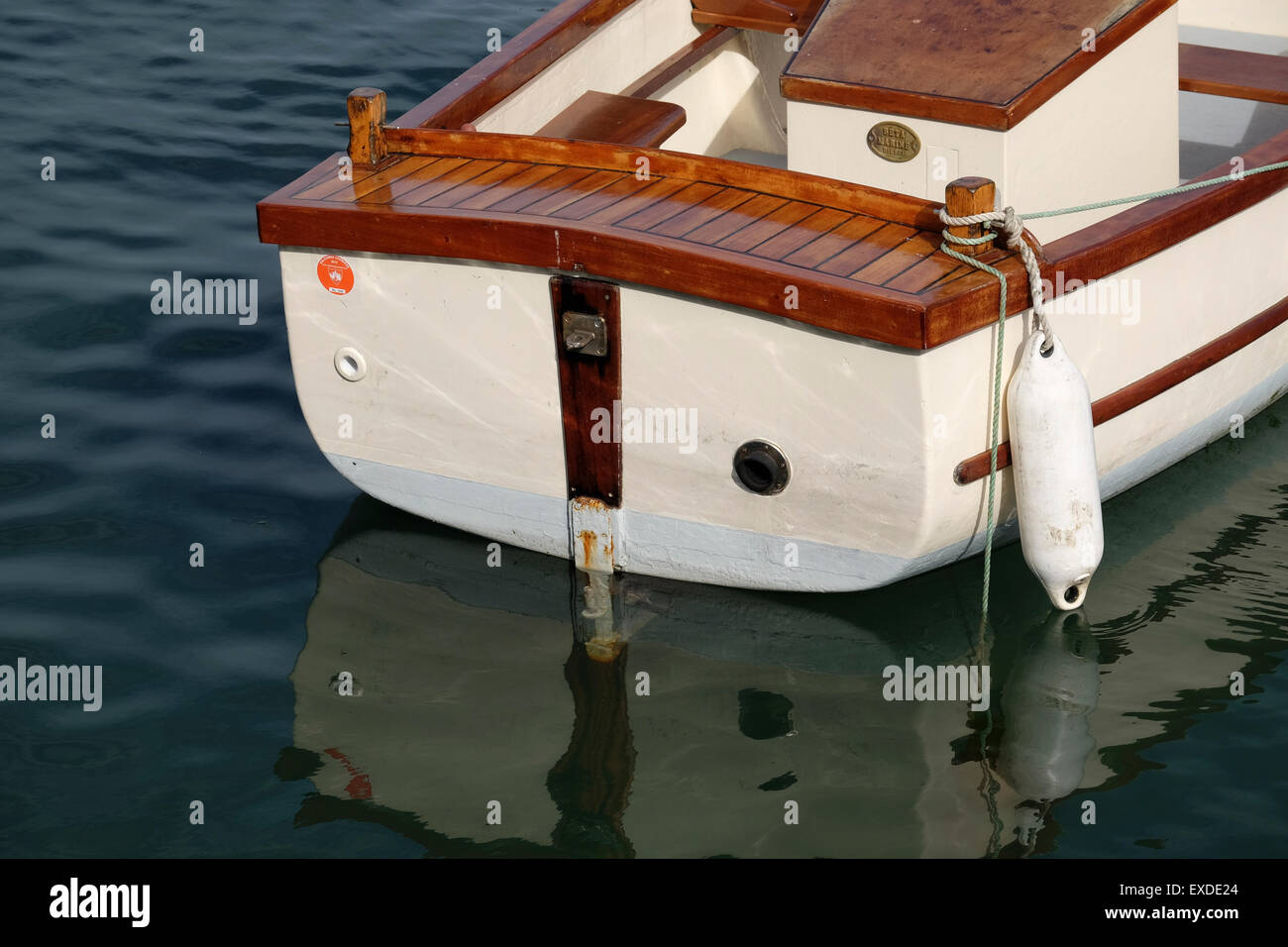 Small wooden rowing boat with polished wood - Stock Image
