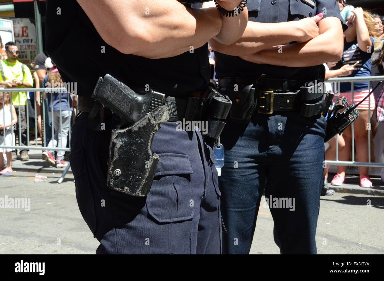 Pair of NYPD police officers with gun belts - Stock Image