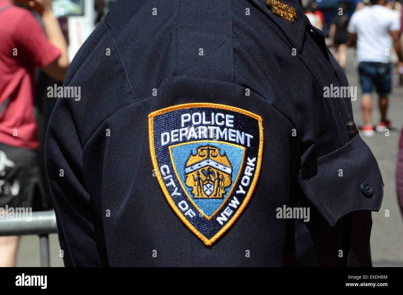 NYPD badge on shirt of a cop in New York City - Stock Image