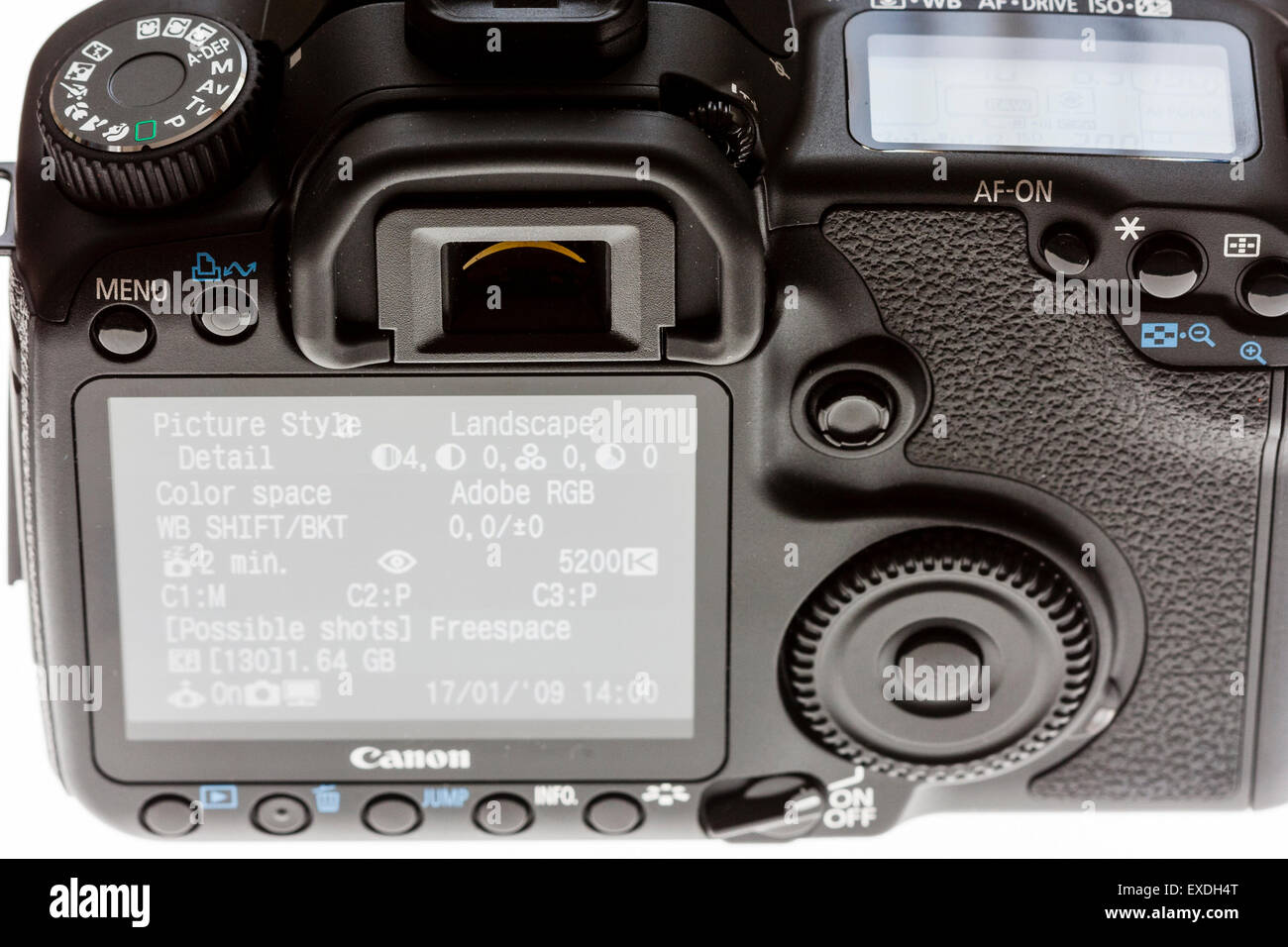 Back of Single lens reflex digital Canon Camera, EOS 40d, with menu on back screen displayed - Stock Image