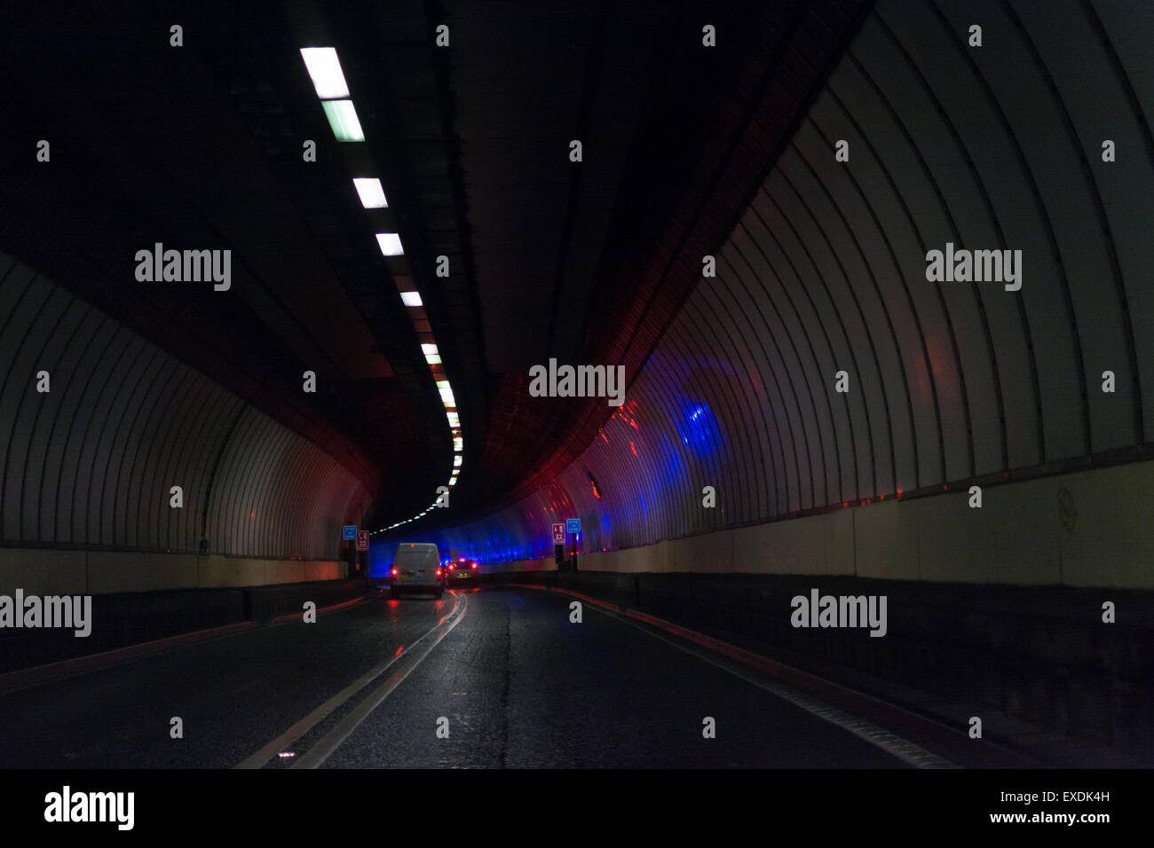 The Clyde Tunnel, Glasgow, Scotland, UK - Fire Engine lights reflected on the walls of the Clyde Tunnel - Stock Image