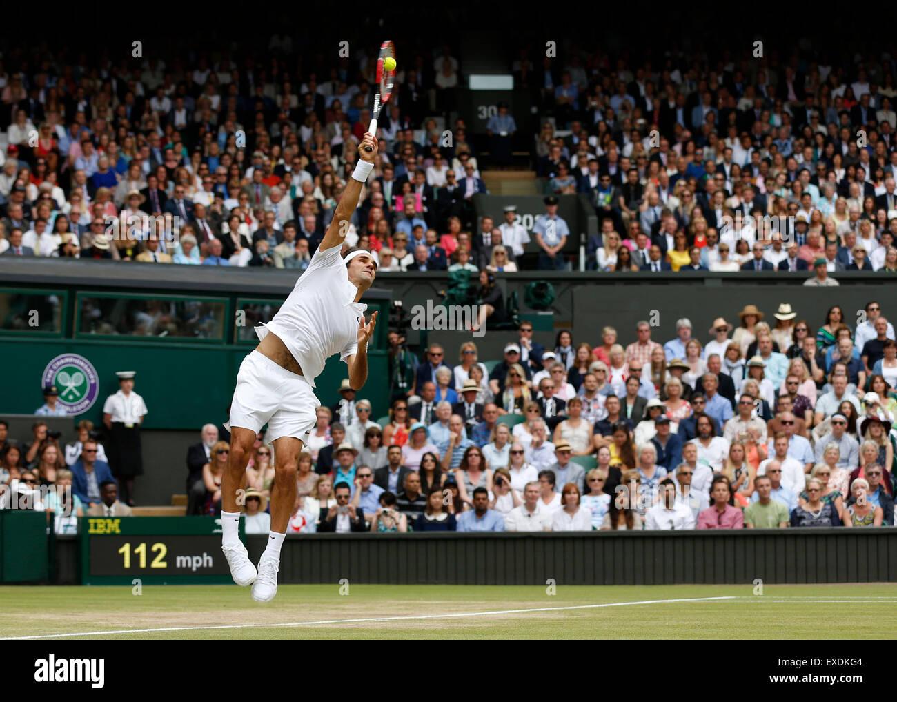 Wimbledon, London. 12th July, 2015. Roger Federer of Switzerland serves to Novak Djokovic of Serbia during the men's - Stock Image