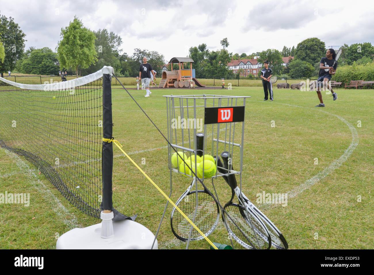 Hampstead Heath, London, UK. 12th July 2015. People playing T3 three a side tennis on Hampstead Heath © Matthew Stock Photo