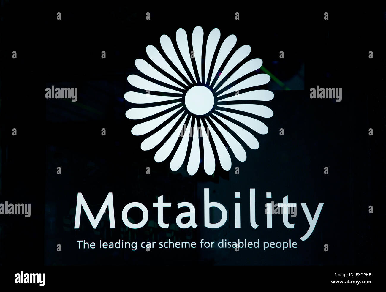 Motability car scheme for disabled people logo in car showroom window, London - Stock Image