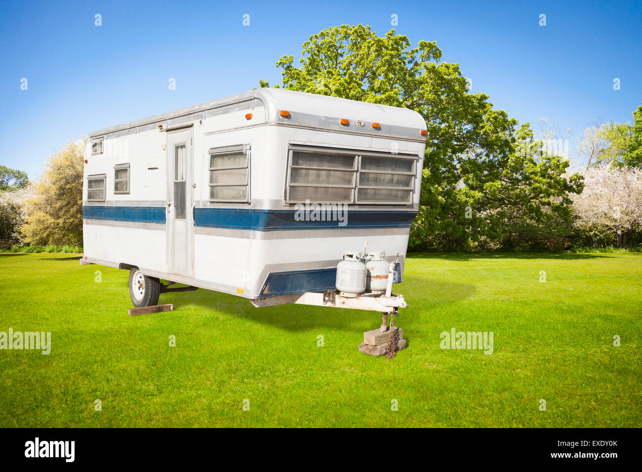 Classic Old Camper Trailer In Grass Field With Beautiful
