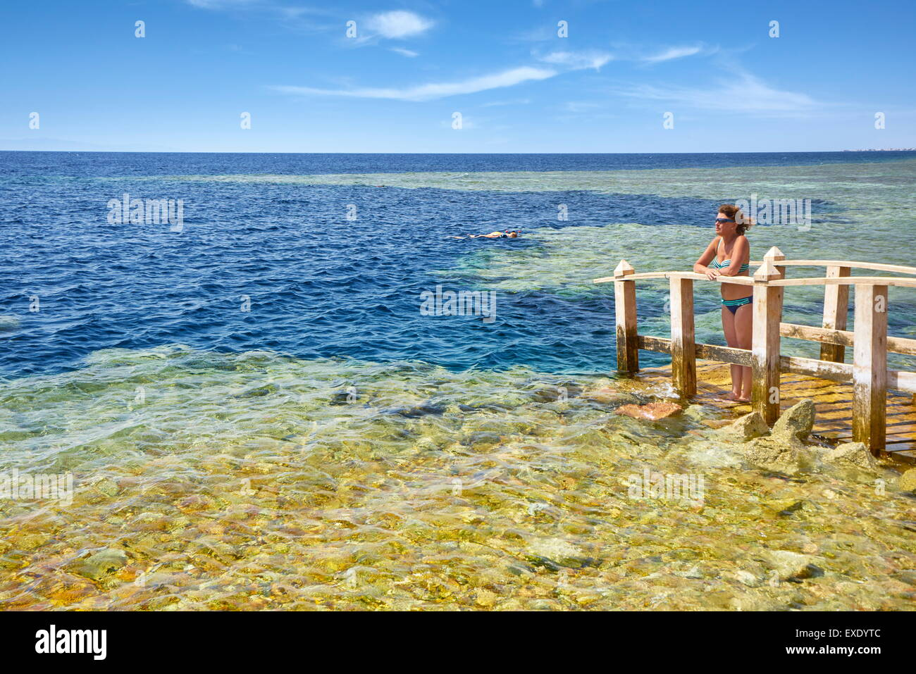 Woman on the platform,going down to the Blue Hole, Dahab, Red Sea, Egypt - Stock Image