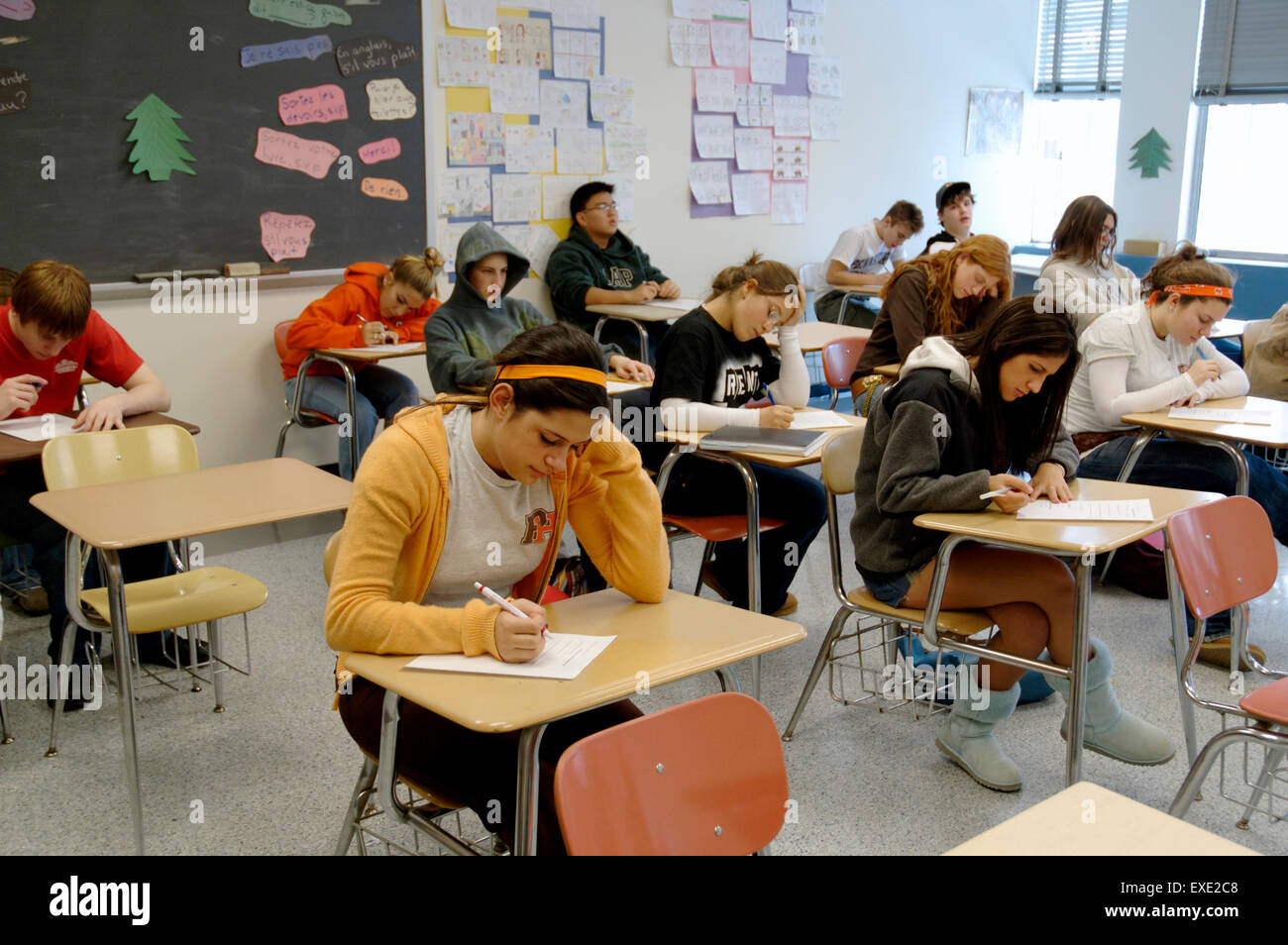 High school secondary students in classroom taking test - Stock Image