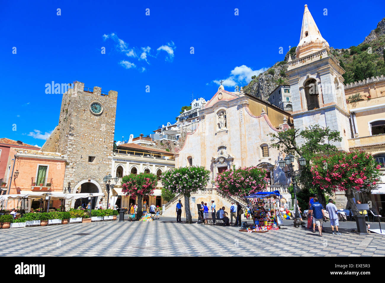 Borgo Medievale Clock tower and San Giuseppe Church  at IX Aprile Square, Corso Umberto, Taormina village, Sicily Stock Photo
