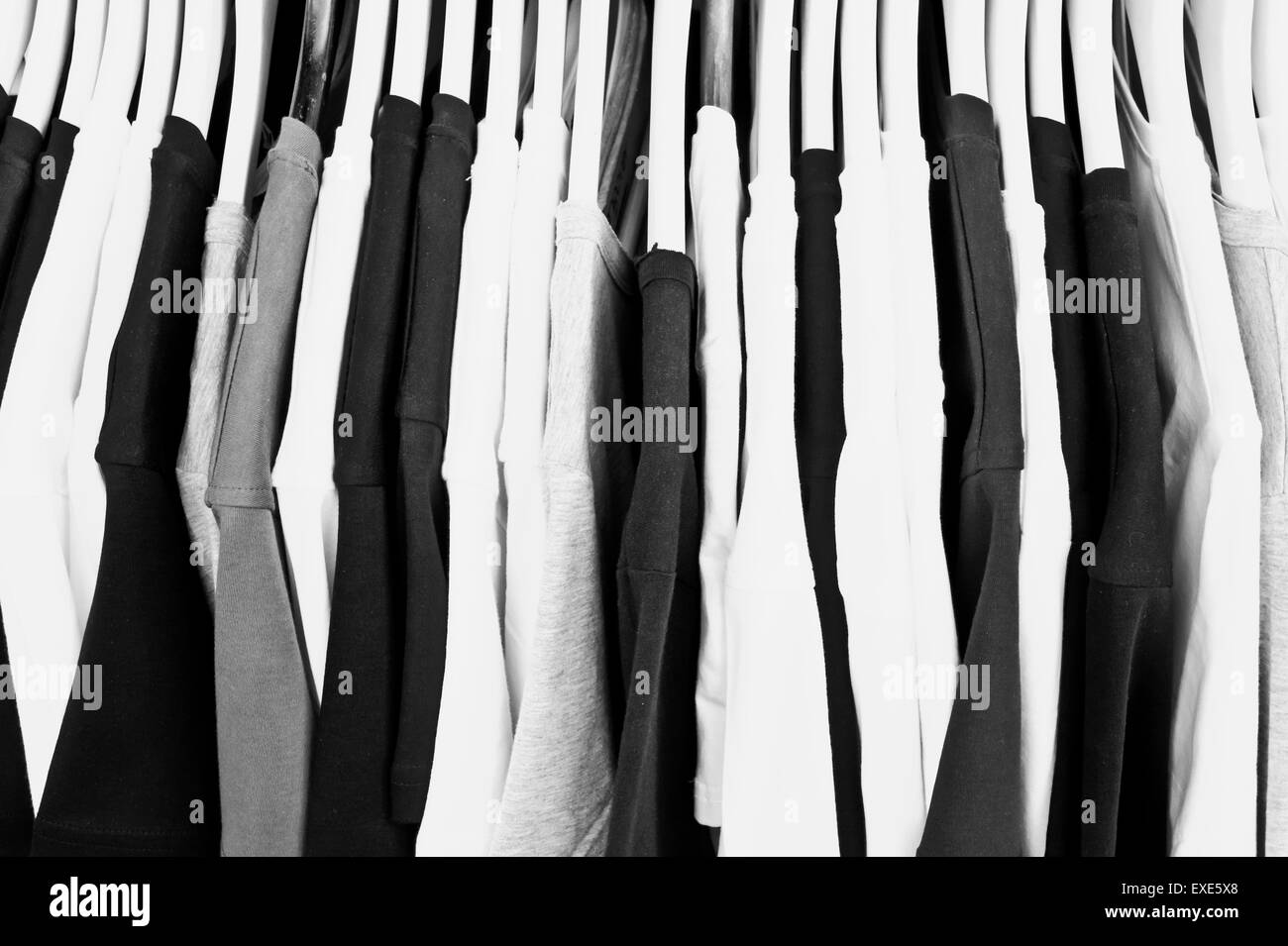 Black white and grey casual tops on a clothing rack Stock Photo