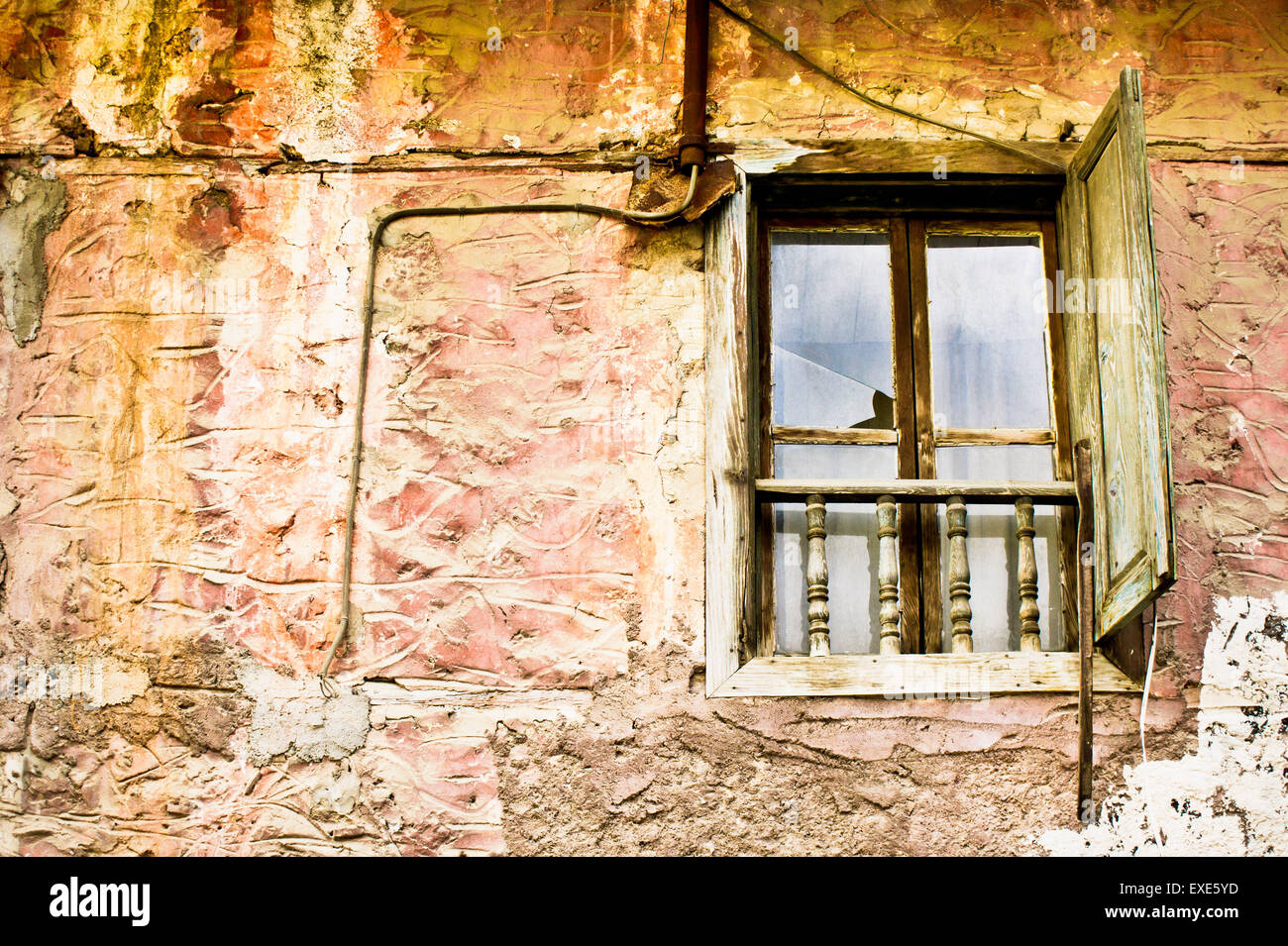 A window in an old derelict house in Turkey Stock Photo