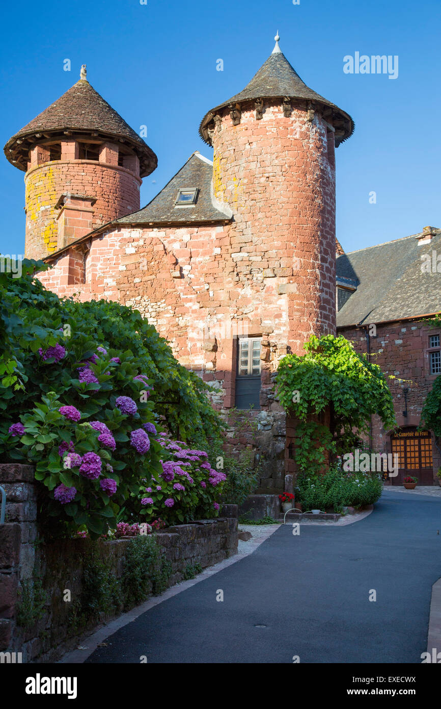 View down street in medieval town of Collonges-la-Rouge, in the ancient Department of Limousin, Correze, France - Stock Image