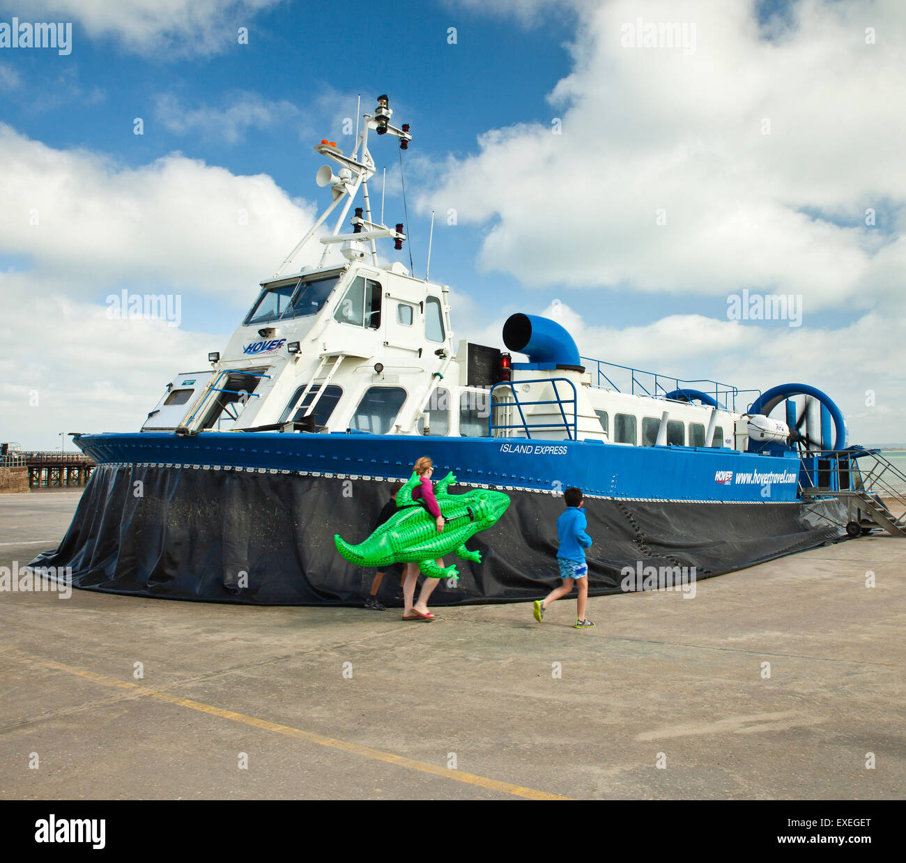 Family boarding the Isle of Wight hovercraft at Ryde. - Stock Image