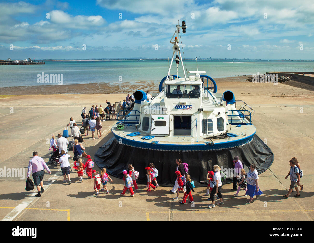 Passengers embarking the Isle of Wight Hovercraft at Ryde. - Stock Image