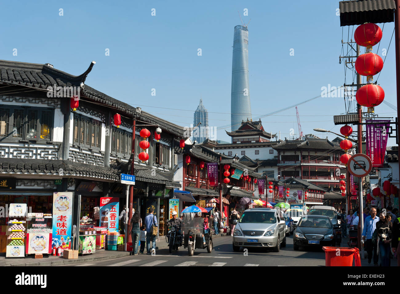 Shopping street, red lanterns, houses in the old style, old city bazaar, Nanshi, Jin Mao Tower and Shanghai Tower - Stock Image