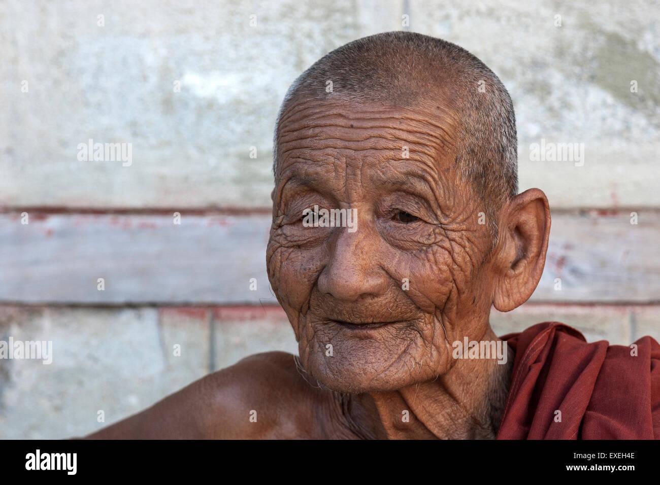 Old monk, portrait, Shwe Yan Bye Monastery, near Nyaungshwe, Inle Lake, Shan State, Myanmar - Stock Image