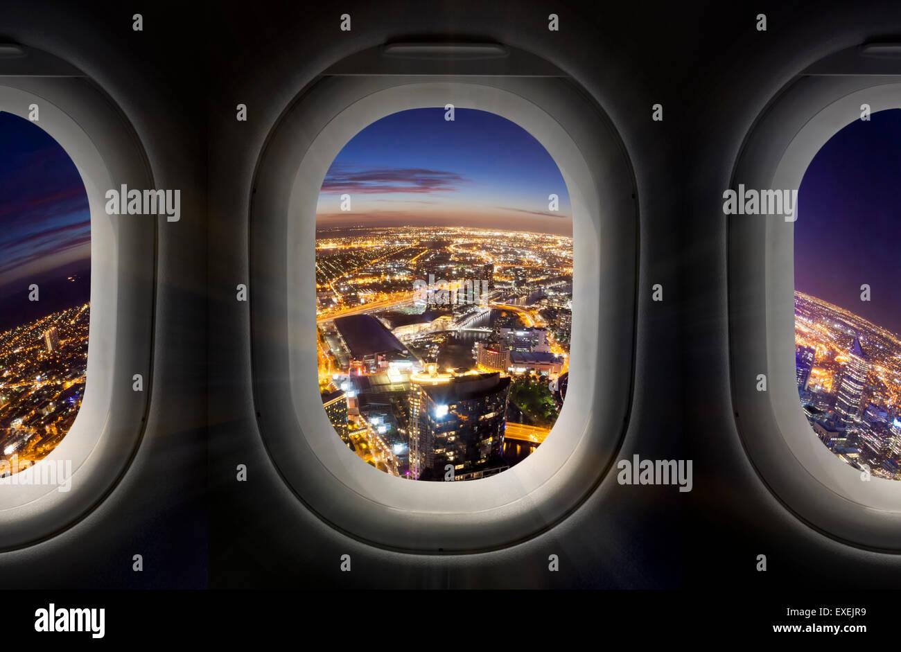 City At Night Through Airplane Window Stock Photo Alamy