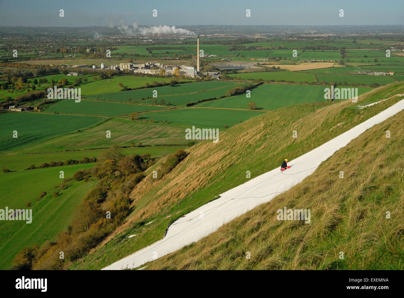 Painting the Westbury white horse (Bratton Camp hillfort). Stock Photo