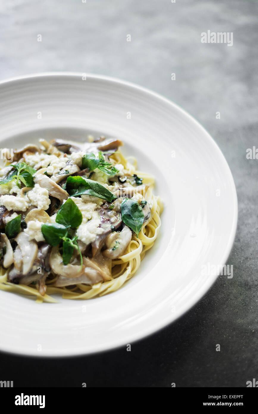 vegetarian mushroom ricotta and herb tagliatelle pasta - Stock Image