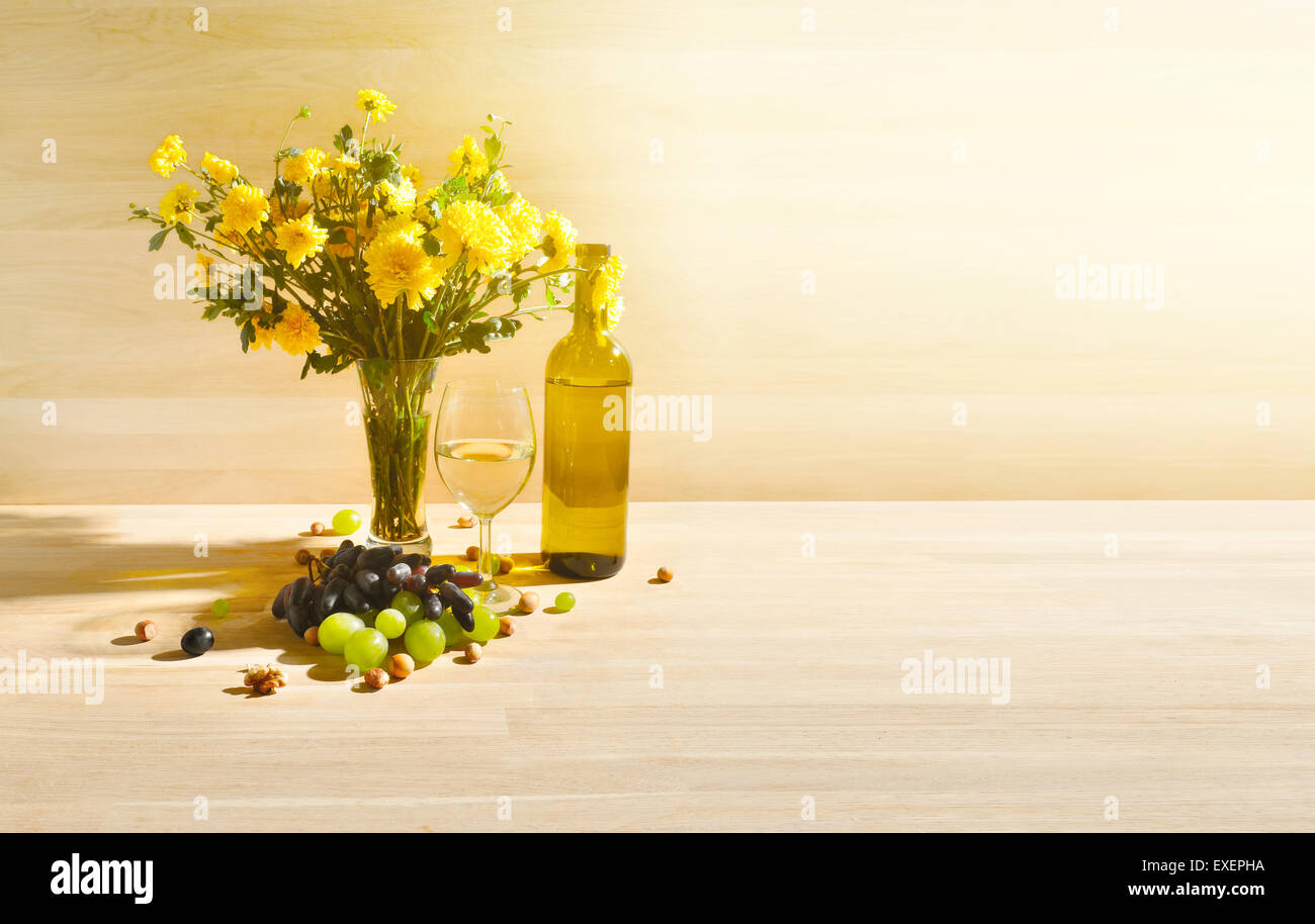 Still life with glass of white wine grapes and flowers stock photo still life with glass of white wine grapes and flowers mightylinksfo