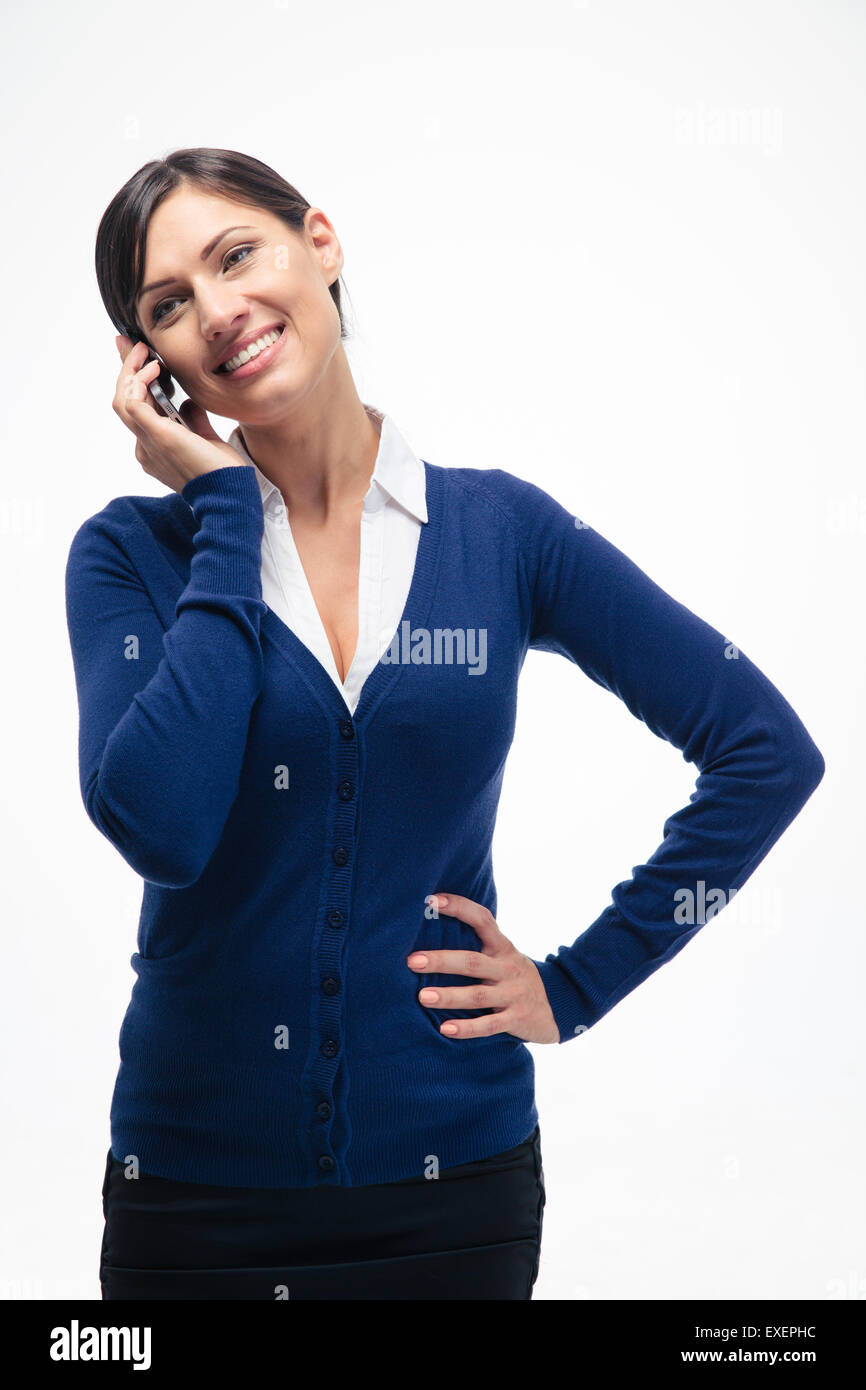 Happy businesswoman talking on the phone isolated on a white background - Stock Image