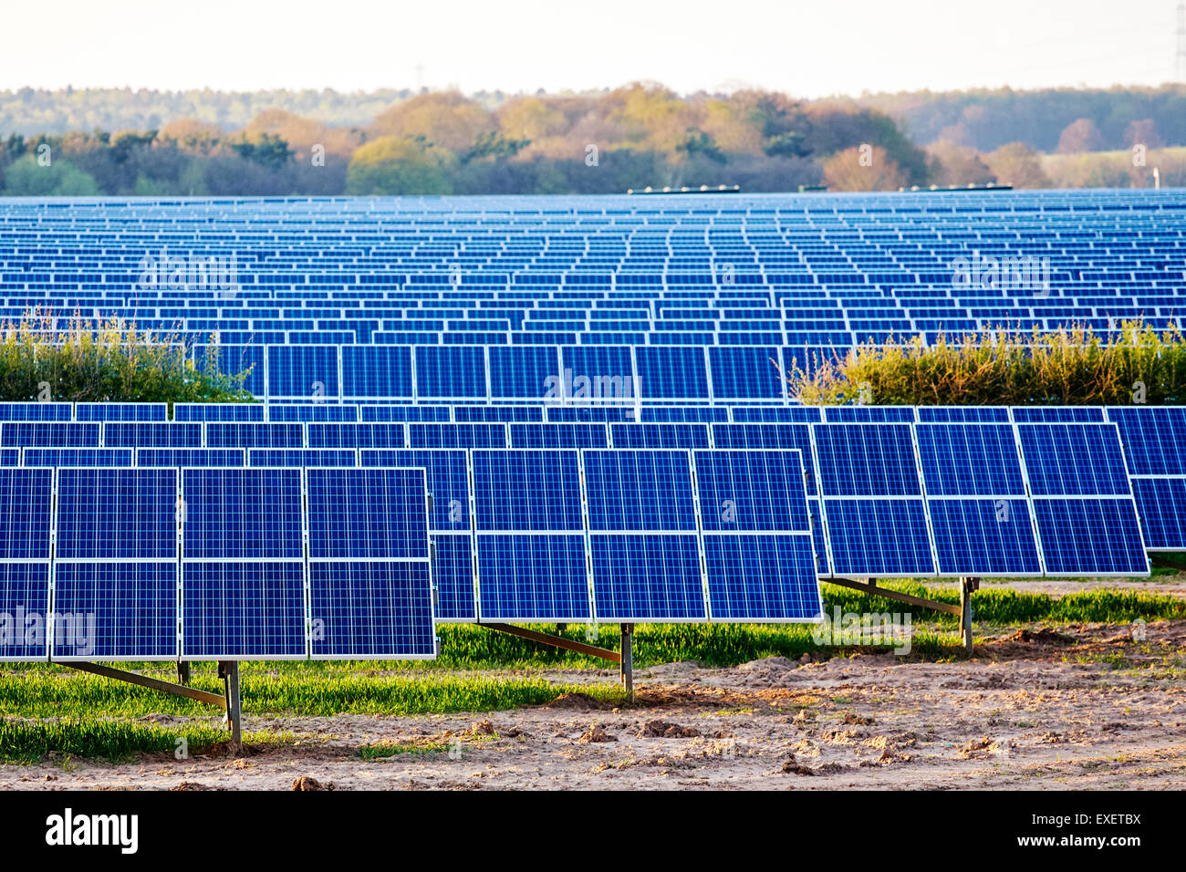 view of a solar power generation plant in a fileld in England - Stock Image