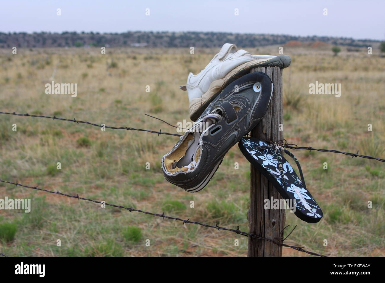 Shoes nailed to a fence post by the side of Route 66 in New Mexico USA - Stock Image