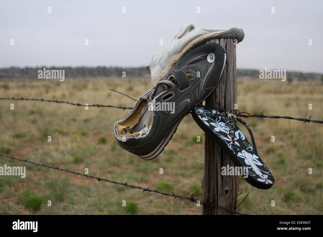 Shoes nailed to a fence post by the side of Route 66 in New Mexico - Stock Image