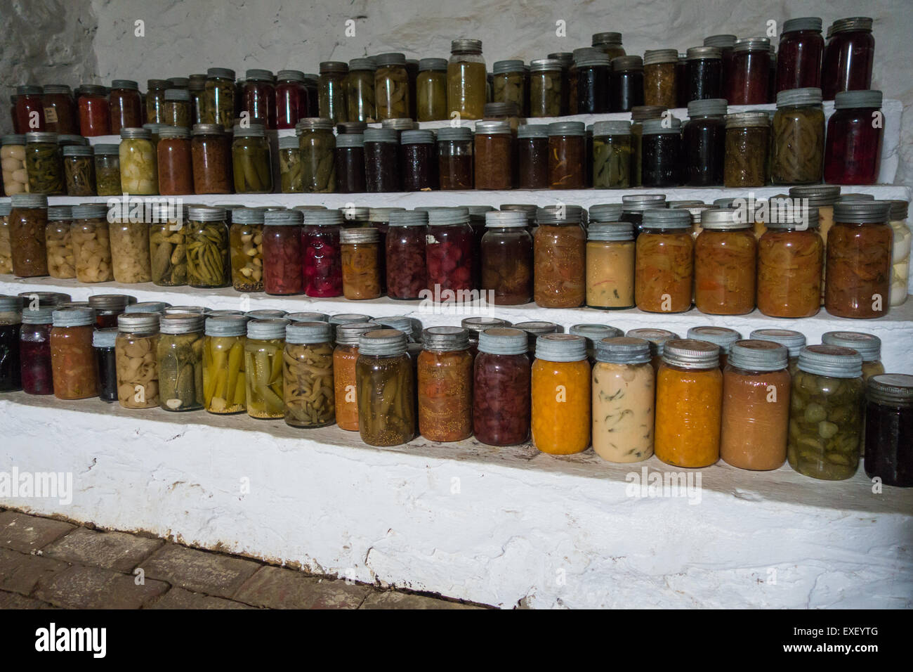 basement food glass jar jars preserved preserving - Stock Image