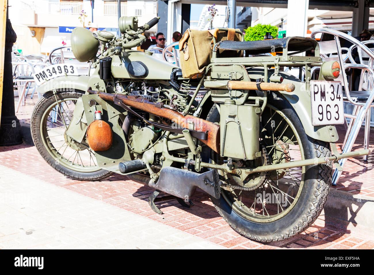 peugeot motorbike ww2 army motorcycle bike colors colours gun weapon water bottle - Stock Image