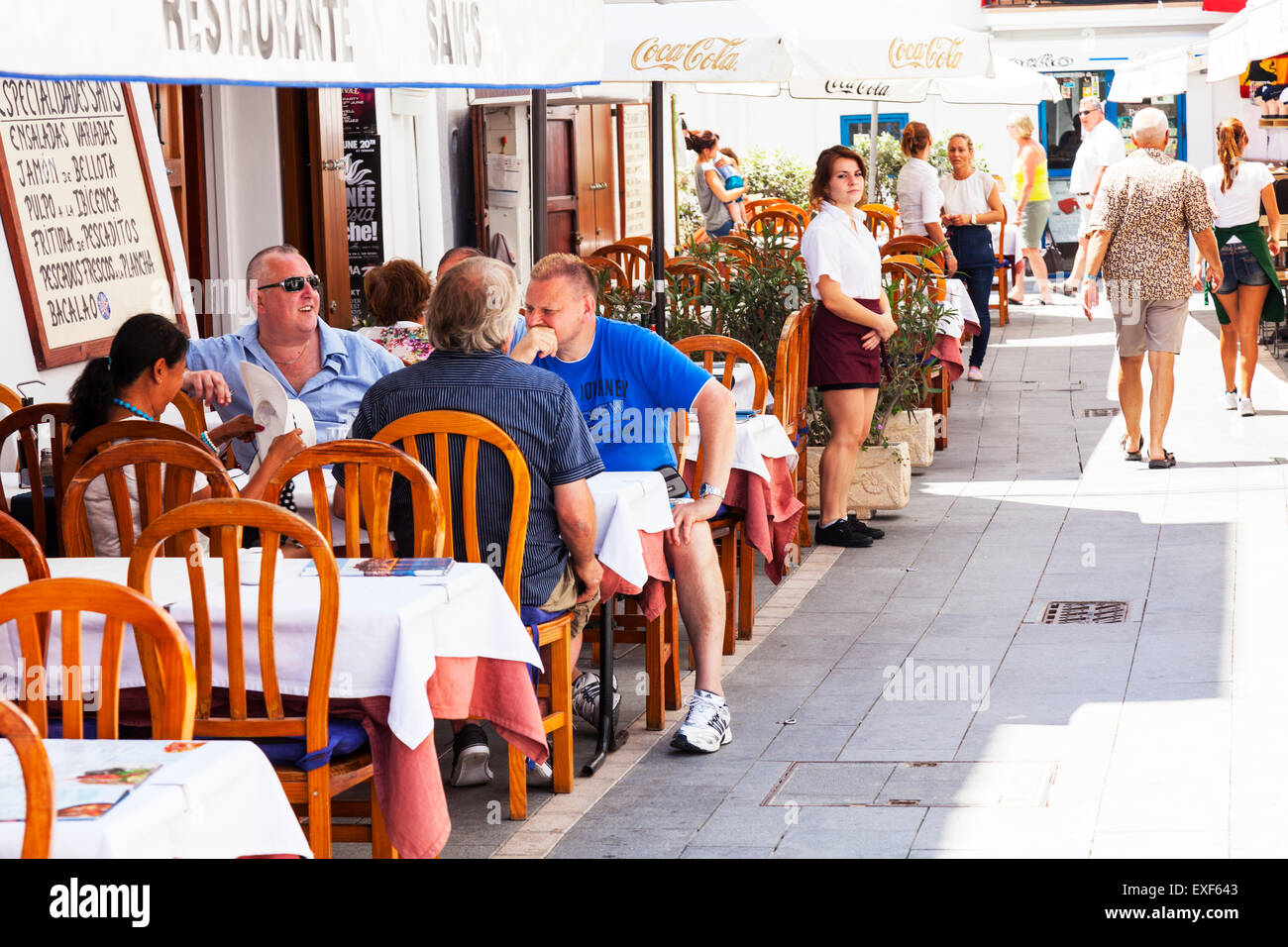 Dining eating out in Ibiza town restaurant café diner tapas Spanish eateries diners al fresco outside on street - Stock Image