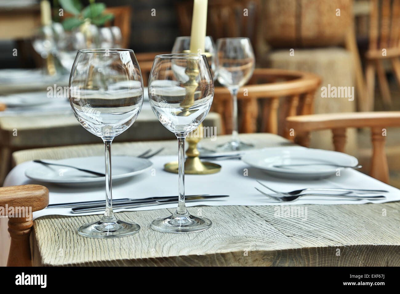 Table Setting With Wine Glasses At The Vintage Cafe Stock Photo