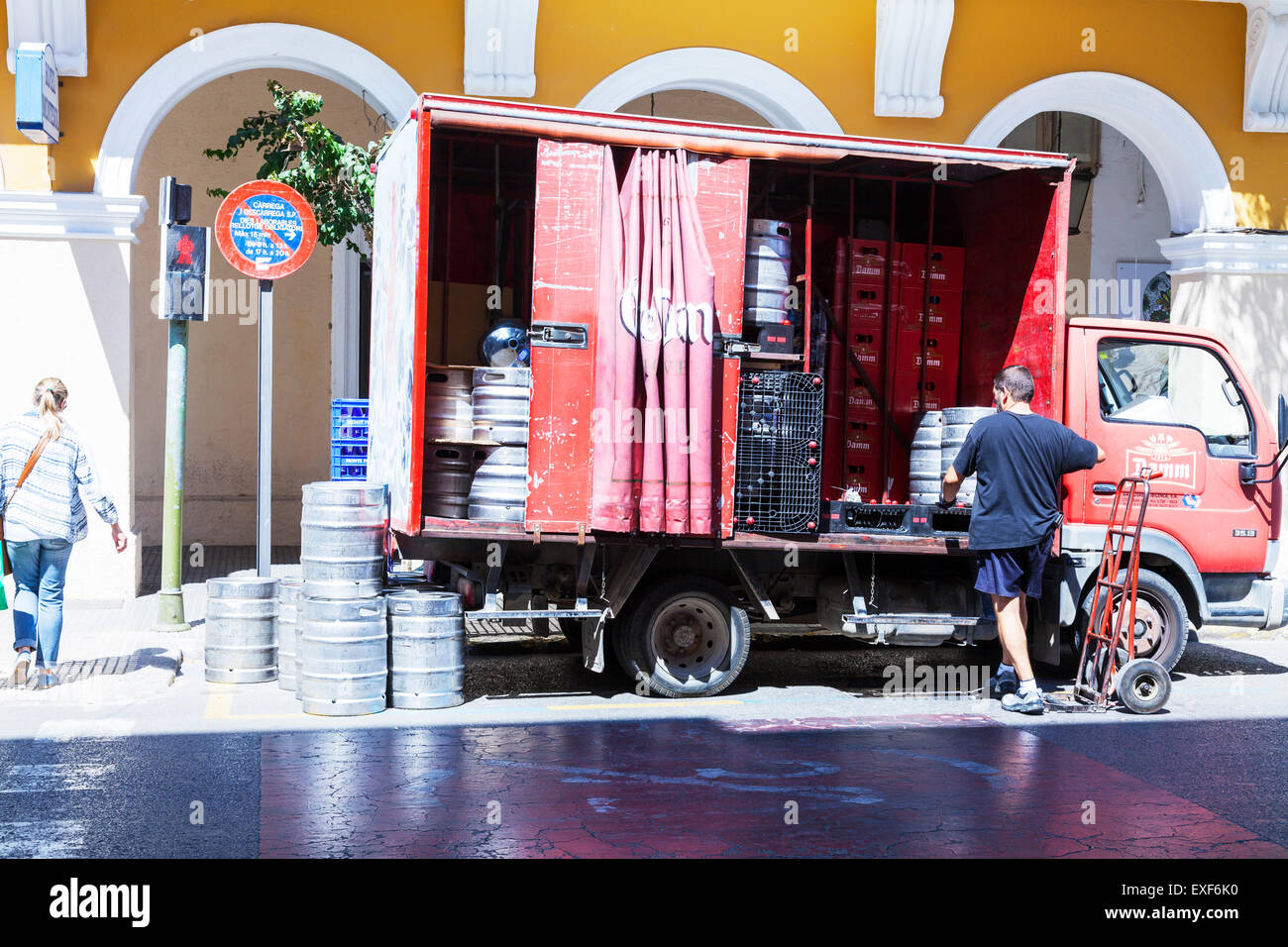 Beer delivery barrels of ale being delivered barrel crate crates in Ibiza Spanish island Spain - Stock Image