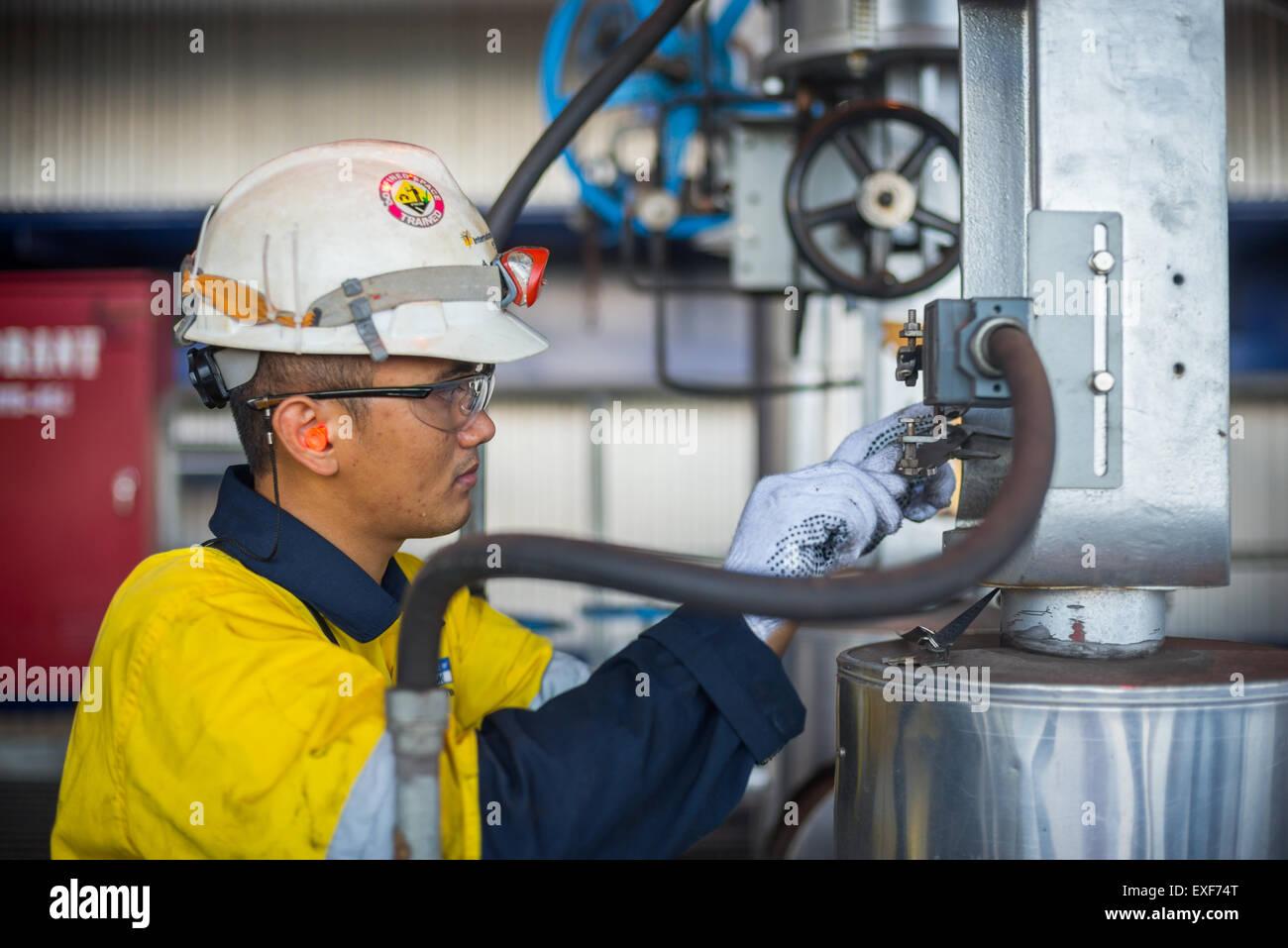 Technician doing maintenance work at coal-fired power plant