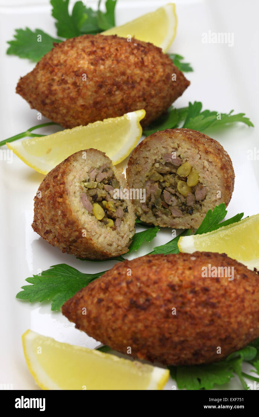 homemade kibbeh, middle eastern food, fried croquette with bulgur and minced lamb - Stock Image