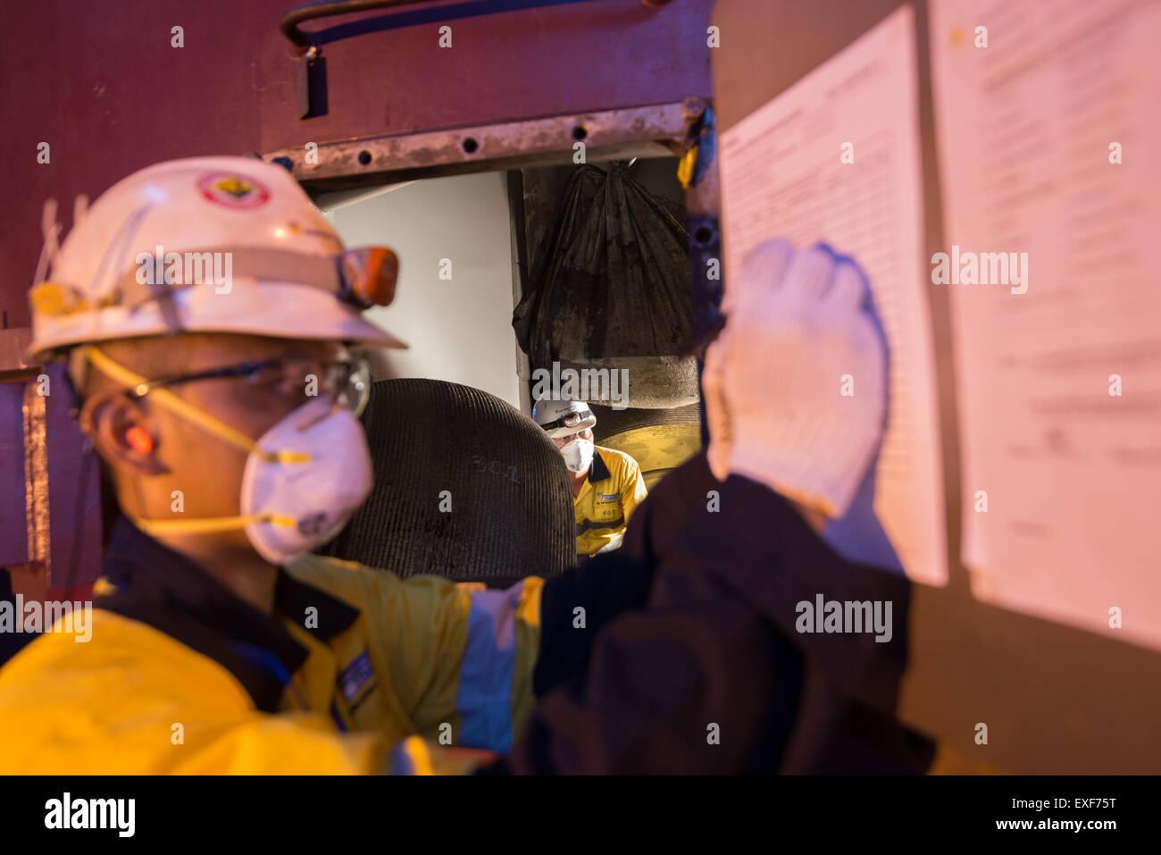 Power plant technician fills maintenance activity checklist form. © Reynold Sumayku - Stock Image
