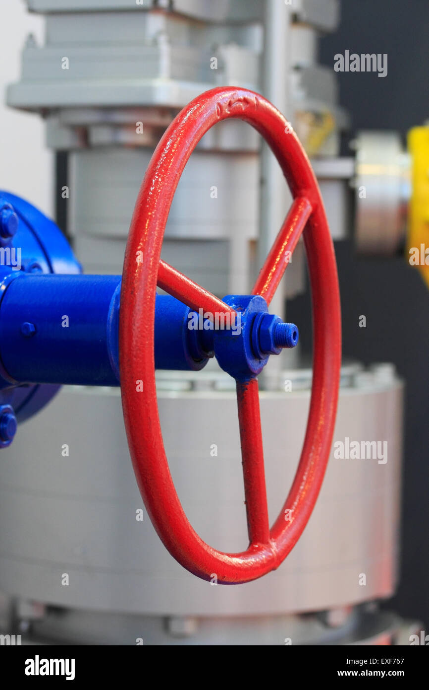 Red handwheel of the industrial steel gate valve. - Stock Image