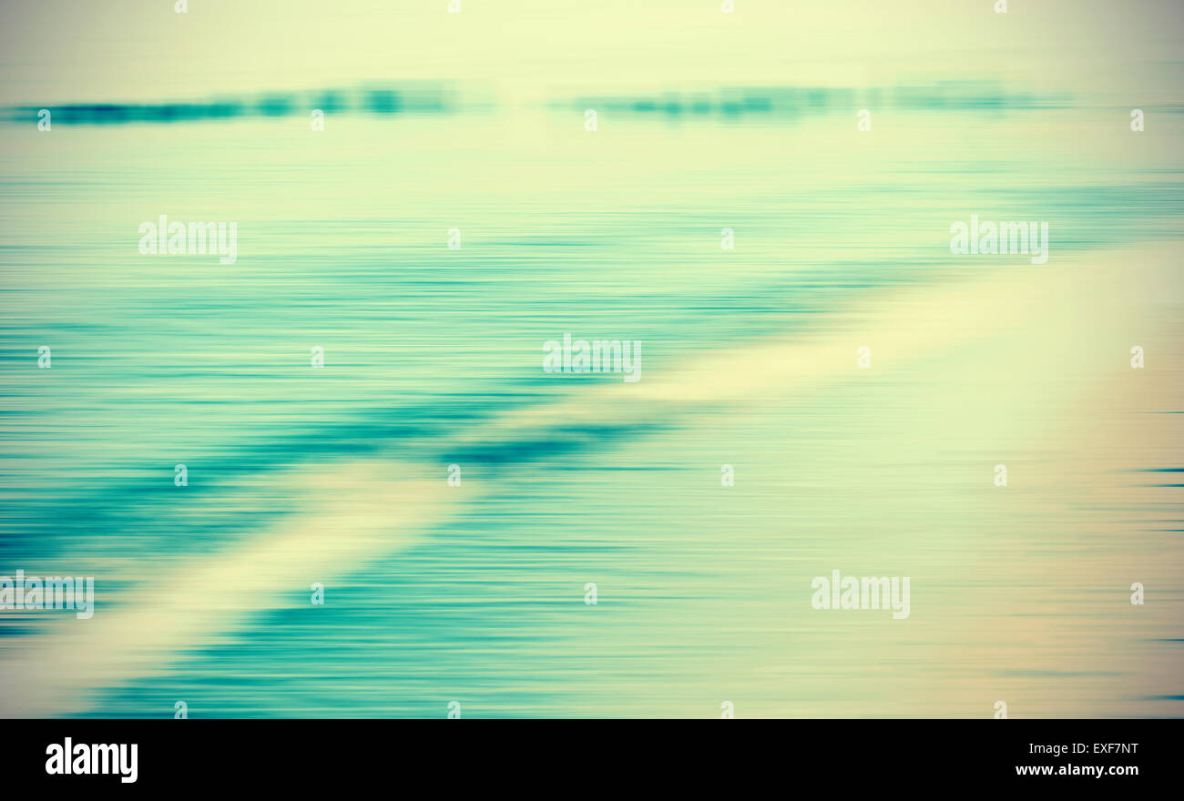 Motion blurred sea background, retro cross processed colors. - Stock Image